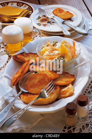 Breaded celery steak with coloured potato salad, Czech Republic, recipe available for a fee - Stock Photo
