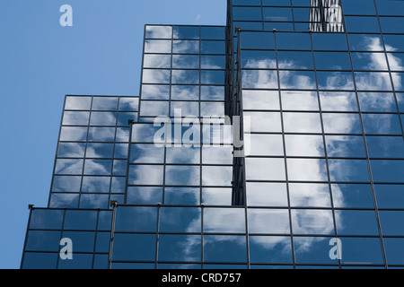 Glass sheathed office tower: Constitution Square building. The stair stepped edges of a glass covered skyscraper - Stock Photo