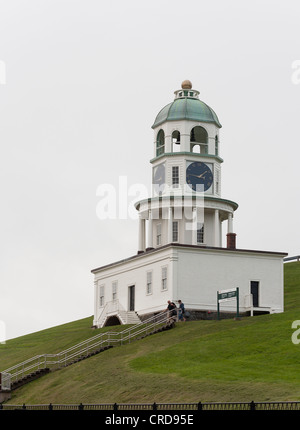 Two tourists descend the steps from the Halifax Town clock tower. Old Town Clock on Halifax's Citadel Hill. - Stock Photo