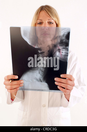 woman doctor with x-ray - Stock Photo