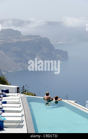 Couple enjoying the view of Santorini from hotel Greece - Stock Photo