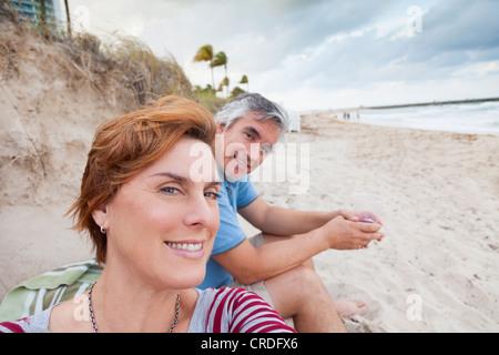 Man and woman at the beach, Bal Harbor, Miami, Florida - Stock Photo