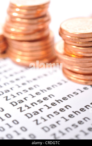 Euro cent coins on a bank statement - Stock Photo