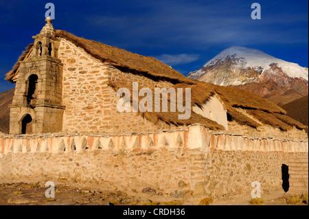 Old chapel in front of Sajama Mountain, Sajama National Park, La Paz, Bolivia, South America - Stock Photo