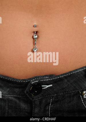 belly button with belly button piercing - Stock Photo