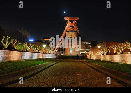 Industrial buildings illuminated at night, Zeche Zollverein Coal Mine, Essen, North Rhine-Westphalia, Germany, Europe - Stock Photo