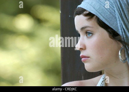 portrait of a beautiful woman with earrings and headress, Germany - Stock Photo