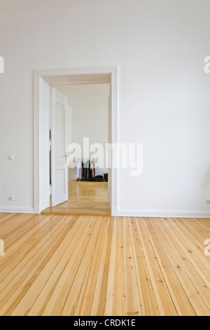 New Hardwood Flooring In An Apartment With Floor To Ceiling Windows