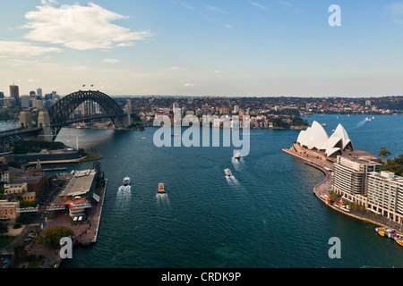 Sydney Cove, with the Opera House and Sydney Harbour Bridge in the harbour, Sydney, New South Wales, Australia - Stock Photo