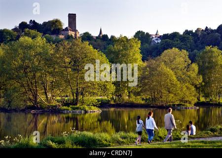 family near the Ruhr river looking towards Hattingen Blankenstein Castle, Germany, North Rhine-Westphalia, Ruhr - Stock Photo