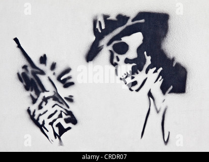 Mobile phone, skull, symbolic image for dangerous cell phone radiation - Stock Photo