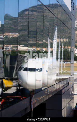 Vueling A-320 Aircraft reflected in glass sided terminal, Malaga Airport, Malaga, Andalusia, Spain, Western Europe. - Stock Photo