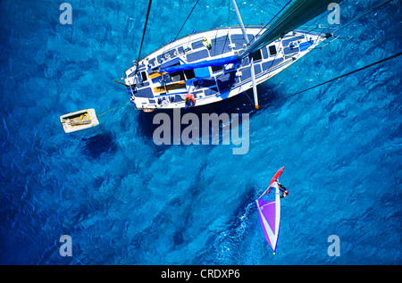 view from a boat mast on a sailing ship and a windsurfer - Stock Photo