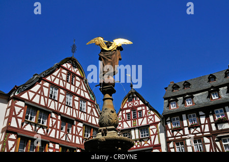 Michaelsfigur statue on Michaelsbrunnen fountain in front of Bernkastel town hall, Marktplatz square in Bernkastel - Stock Photo