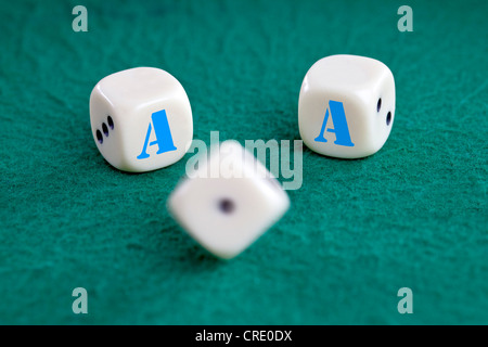 Dice with the letter A are cast, symbolic image for the award of the triple-A rating of rating agencies - Stock Photo