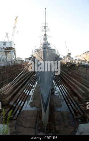 Ship in the harbour, bow of a museum ship, navy warship, the destroyer USS Cassin Young DD-793 in dry dock - Stock Photo