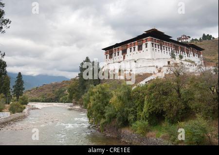 Tibetan Buddhism, Rinpung Dzong Monastery and Fortress beside a river, Paro, Himalayas, Bhutan, South Asia, Asia - Stock Photo