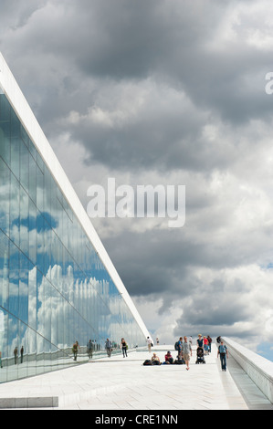 Modern architecture, inclined plane, dark clouds reflected in the glass, New Opera House, Operaen, Oslo, Norway, - Stock Photo