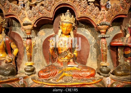 Tibetan Buddhism, Newari-style sculptures, colourfully painted statues made of wood and clay, yellow Buddha statue, - Stock Photo