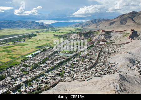 Tibetan Buddhism, aerial view, Palcho Monastery with the Kumbum Stupa behind the historic district, also known as - Stock Photo
