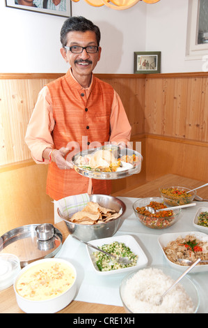 Ayurvedic chef Nicki Sabnis presenting Indian dishes, Frauenchiemsee or Fraueninsel in Lake Chiemsee, Chiemgau, - Stock Photo