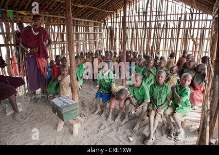 Education and poverty, children in a primary school class with a teacher, ethnology, Masai, village of Kiloki, Savannah