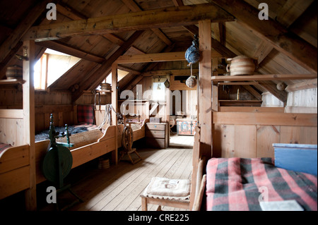 Living in the Middle Ages, interior view, wooden furniture, old sod house, turf and sod constructions, open-air - Stock Photo