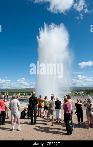Tourists watching the Strokkur geyser erupting, hot spring, Haukadalur, Golden Circle, Iceland, Scandinavia, Northern - Stock Photo