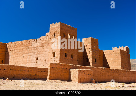 Taouirt Kasbah, mud fortress, mud brick buildings of the Berber tribes, Tighremt, Draa Valley, Southern Morocco, - Stock Photo