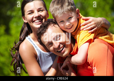 Portrait of a lovely family having good time outdoors - Stock Photo