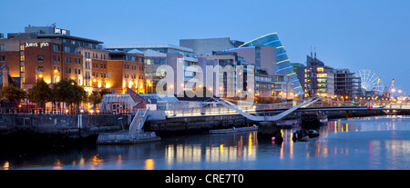 The Docklands, the former port area, with the Convention Centre Dublin on the River Liffey in Dublin, Ireland, Europe - Stock Photo