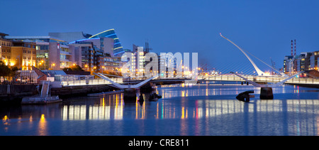 The Docklands, the former port area, with the Convention Centre Dublin and the Samuel Beckett Bridge by the architect - Stock Photo