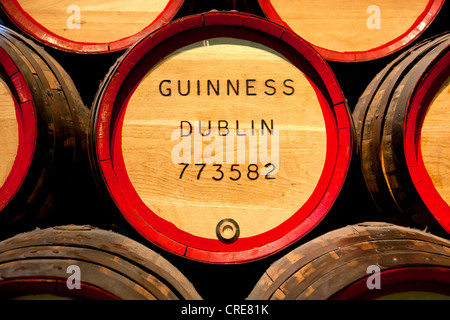 Guinness beer barrels in the museum of the Storehouse in the Guinness brewery, part of the Diageo drinks company, - Stock Photo