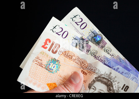 Stirling pound notes in the hand - Stock Photo