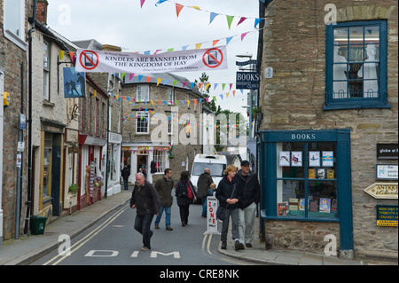 Banner across street in Hay town centre saying Kindles are banned from Hay-on-Wye, Powys, Wales, UK - Stock Photo