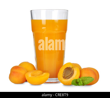 Apricot juice in glass isolated on white background. - Stock Photo