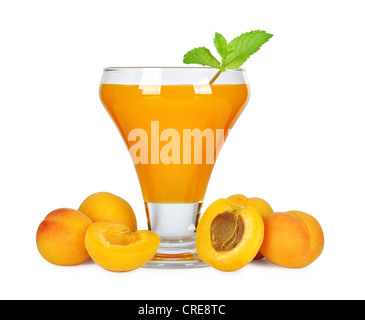 Apricot juice in glass isolated on white background - Stock Photo