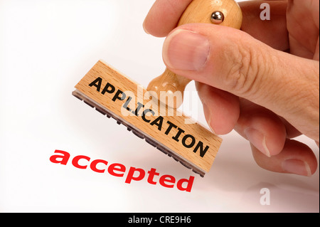 rubber stamp marked with application accepted - Stock Photo