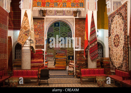 Shop of a carpet dealer in an old riad, city palace in the old town, Medina, Fes, Morocco, Africa - Stock Photo