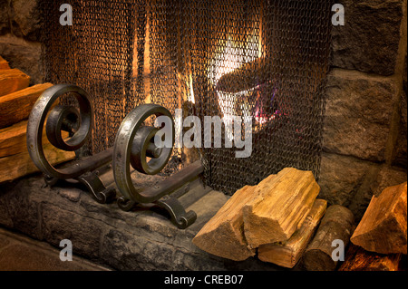 Fire in fireplace with wrought iron grate. Timberline Lodge, Oregon - Stock Photo