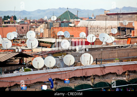 Satellite dishes and aerials on the roofs of buildings in the medina or old town of Marrakech, Morocco, Africa - Stock Photo