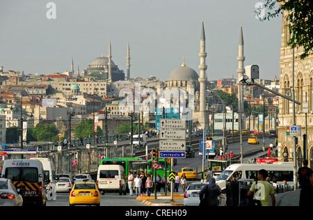 ISTANBUL, TURKEY. A view over the Galata Bridge from Karakoy to Eminonu, with the Yeni and Nuruosmaniye mosques - Stock Photo