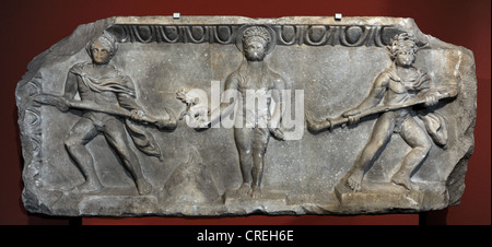 Relief depicting a cult statue of Apollo standing between two torch-bearers. 175-200 AD. Marble. From Miletus. Pergamon - Stock Photo