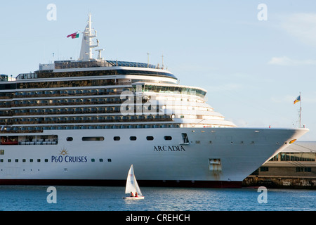 Small sail boat off the cruise ship Arcadia in the marina, Funchal, Madeira, Portugal, Europe - Stock Photo