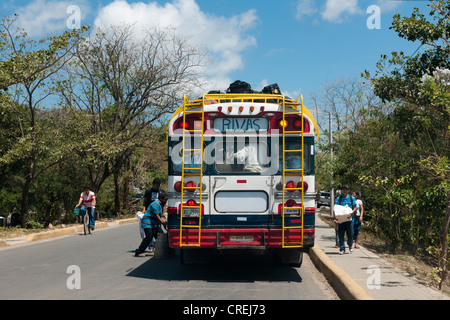 A public bus is being loaded, San Juan del Sur, Nicaragua, Central America - Stock Photo