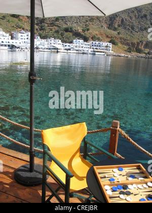 A Tavli board, Loutro, South Crete, Greece - Stock Photo