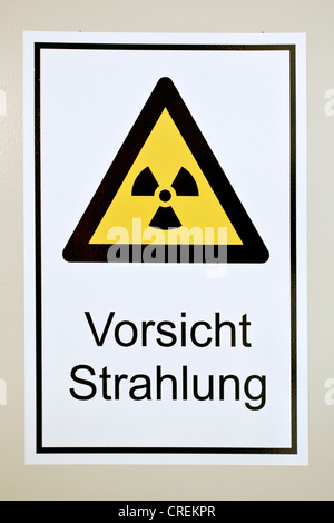 Warning sign, Vorsicht Strahlung or caution radiation - Stock Photo