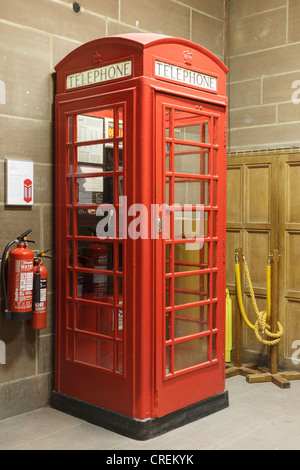 Old K6 cast iron red telephone box designed by Sir Giles Gilbert Scott in Liverpool Anglican cathedral. Merseyside, - Stock Photo