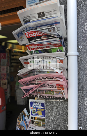Foreign International newspapers on sale at store in famous Lanes shopping district of Brighton Sussex UK - Stock Photo