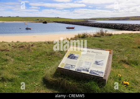View across Weddell Sound to Burray with Churchill barrier causeway and information sign. Glimps Holm Orkney Islands - Stock Photo